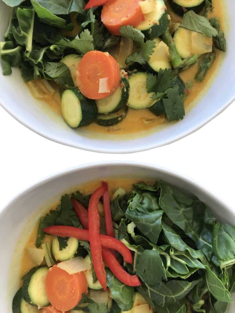 Healthy Vegan Thai Coconut Curry with vegetables. Garnish with cilantro, red bell pepper and enjoy with rice   StarseedKitchen.com