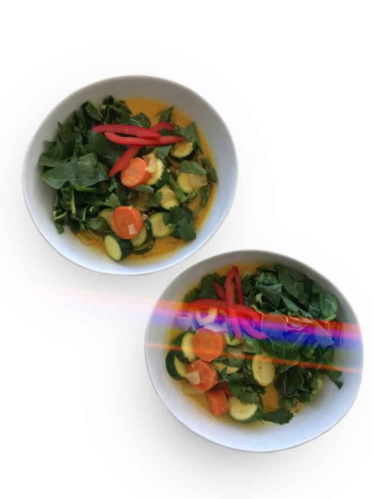 Yellow Coconut Curry with vegetables. Garnish with cilantro, red bell pepper and enjoy with rice | StarseedKitchen.com