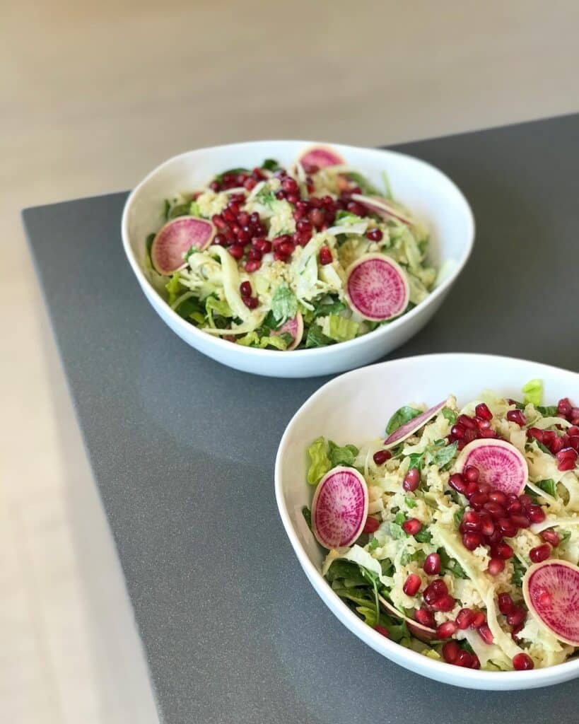 Colorful Freekeh Tabbouleh Salad with Fennel, Pomegranates, Pink Watermelon Radishes Over Romaine Lettuce