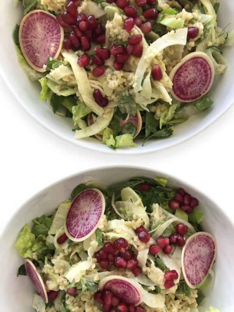 Colorful Freekeh Tabbouleh Salad with Fennel, Pomegranates, Over Romaine Lettuce for a clean eating meal prep salad