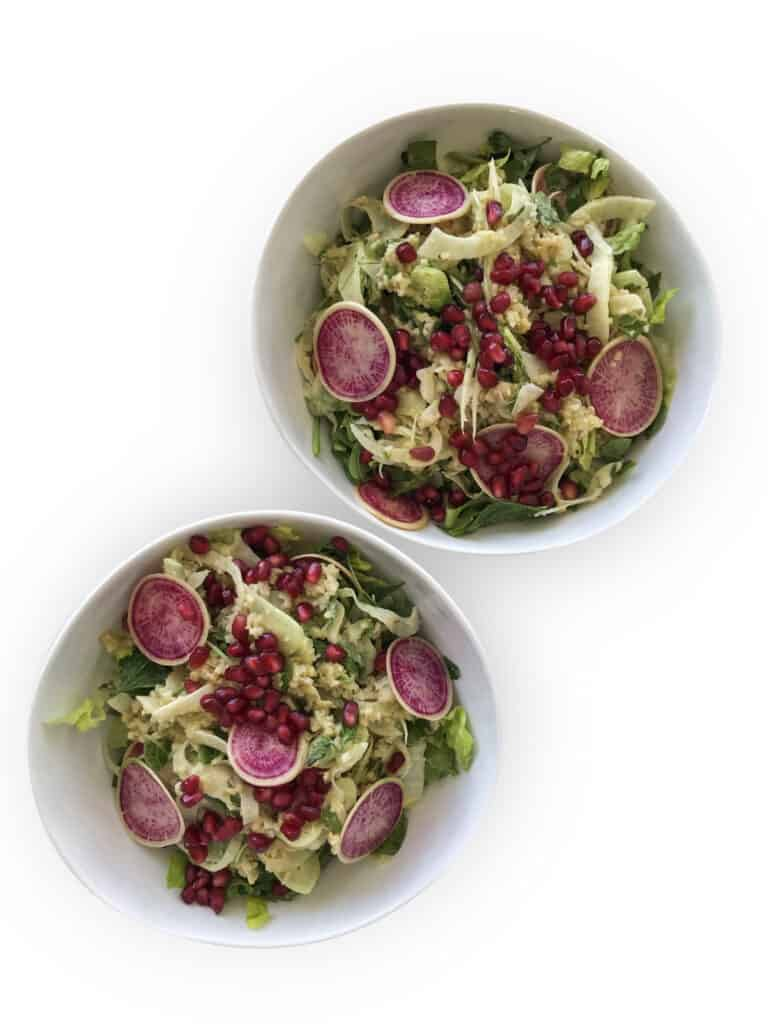 Freekeh Tabbouleh Salad with Fennel, Pomegranates, pink watermelon radishes over romaine lettuce