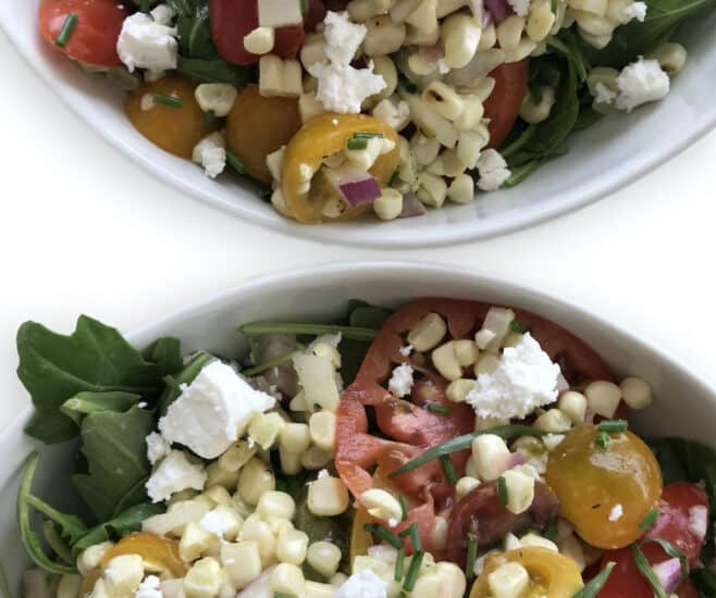 Tomato and Corn Salad with red onion, feta, arugula and chives